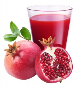 Pomegranate juice with pomegranate on a white background.